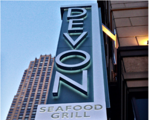 sign outside Devon Seafood Grill
